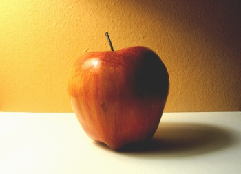shadow of an apple in incandescent light